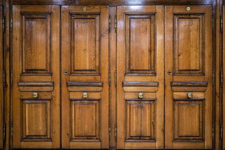 Image of light brown ancient wooden four parts door Imagens