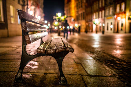 Evening street with benches and lanterns. Night European city Imagens