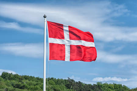 Picture of Flag of Denmark with blue sky at the background