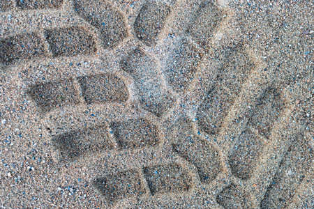 Picture of Tractor footprint on the beach, well defined, isolated and big.