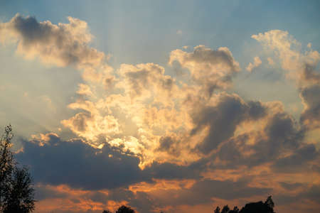 Image of dramatic sunset clouds with blue sky
