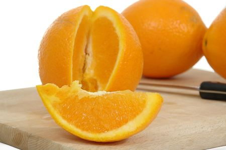 pices: Oranges on white background.