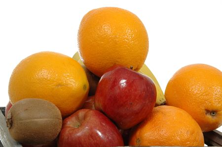 Pile of fruits on whte background. Contaning oranges, appels, bananas and kiwies. Stock Photo - 544813