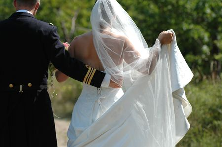 marrage: Groom holding the dress