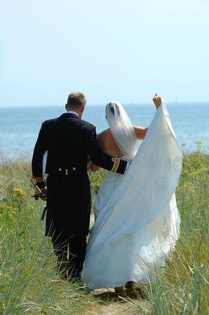 marrage: Wedding couple walking near the sea