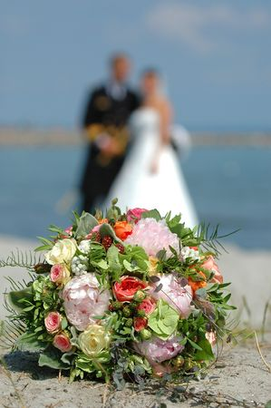 marrage: Bouquet, bride and groom. Focus on the bouquet.