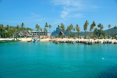 palmtrees: A beuatifu beach with boats and palmtrees Stock Photo