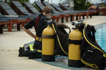 scuba woman: Diver at the swimmingpoll getting ready Stock Photo