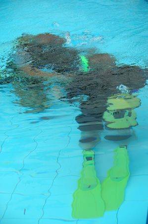 snorkle: A instructor is traning a student how to dive