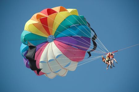 paraglide: People parasailing. Stock Photo