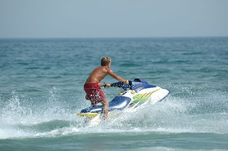 jetski: Young man and his jet-ski Stock Photo