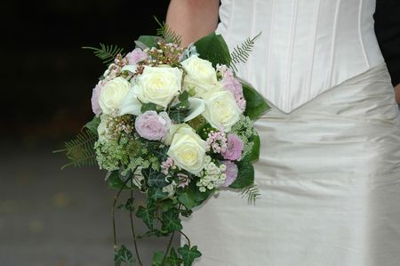 Bride is holding her wedding bouquet. Stock Photo - 596826