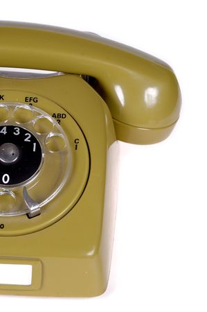 Green old telephone from the 80ties. On clean white background. photo