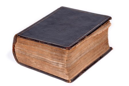 Old bible, over 100 years old, taken on clean white background. photo