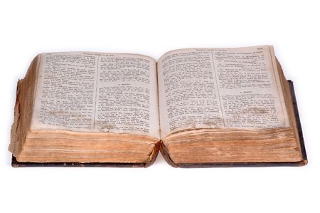 multiple stains: Old bible, over 100 years old, taken on clean white background. Stock Photo
