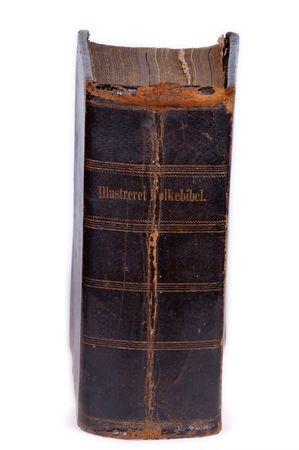 Old bible, over 100 years old, taken on clean white background. On the back it is written: Ilustrated peopels bible. photo