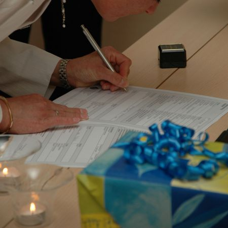 Bride signing the wedding contract. Note that all the tekst is in blur. Stock Photo - 706803