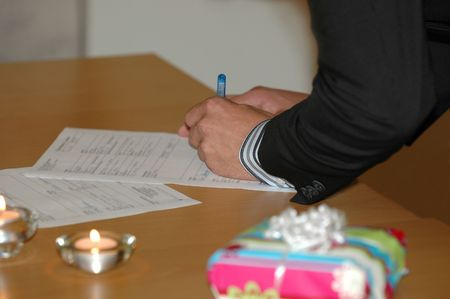 Groom is signing the wedding contract. Stock Photo - 706711