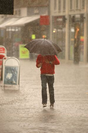 Man is running in the rain. Motion blur. photo