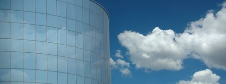 Corporate building and clouds. photo