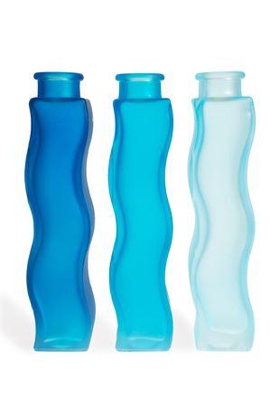 Blue bottles on a row photo
