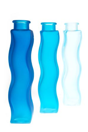 Blue bottles. Note that only the front one is in focus. photo