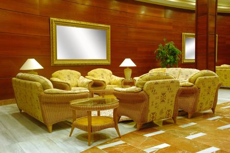 Hotel lobby whit table, chairs and sofas photo