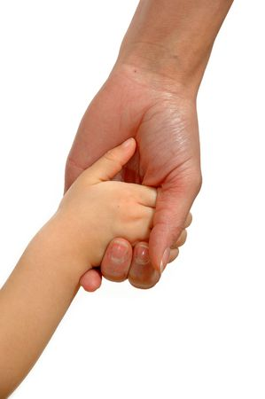 protective: Young child hand holding adult hand.