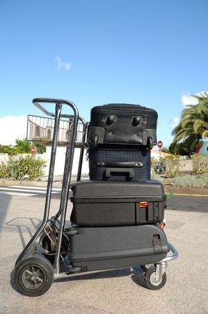 Many suitcases on a cart