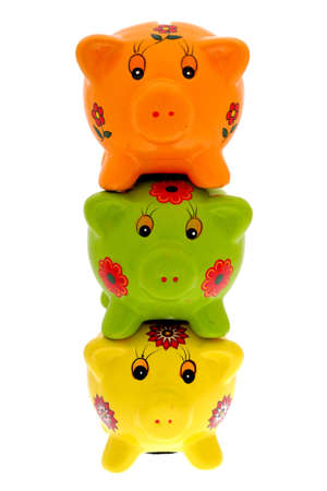 Three piggy banks on top of each other. photo