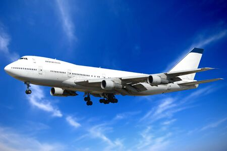 Jumbo jet and blue and cloudy sky. photo