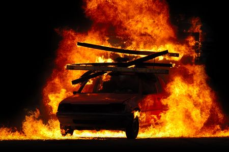 burning man: Car is driving through fire