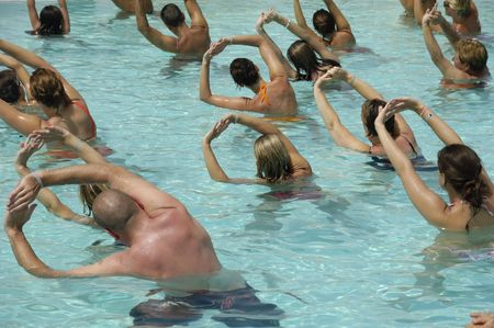 Many people doing sport in a pool photo