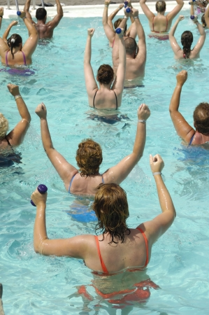 People doing aerobic in a swimming pool photo