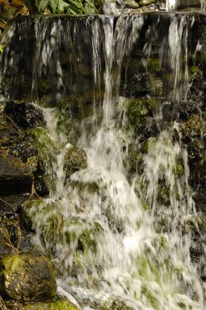Small waterfall. Note the water is in motion blur. photo