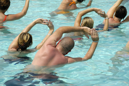 People are doing water aerobic in pool photo
