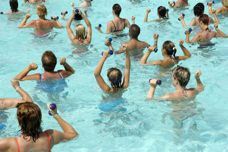 People are doing aerobic in pool photo