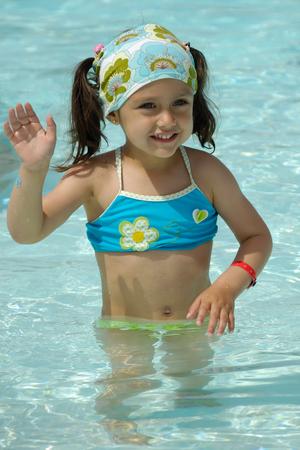 Happy child waving in pool Stock Photo