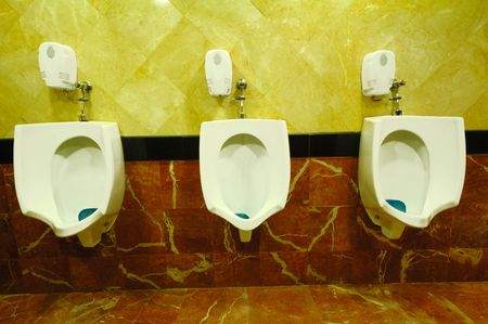 Three Urinals in a row. photo
