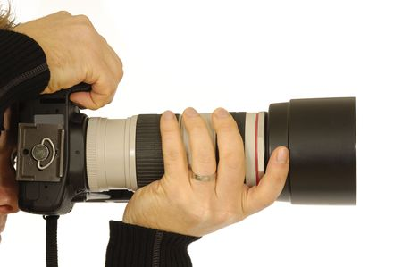 Photograper holding camera. Taken on a clean white background. Stock Photo - 2379308