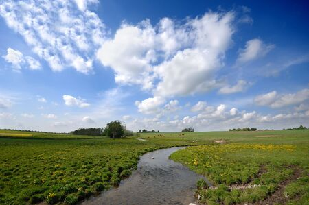 Small river, framland and blue and cloudy sky. Stock Photo - 2387822