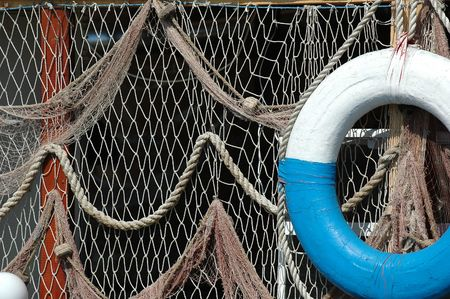 floaters: Old net and old lifebuoy are hanging on land