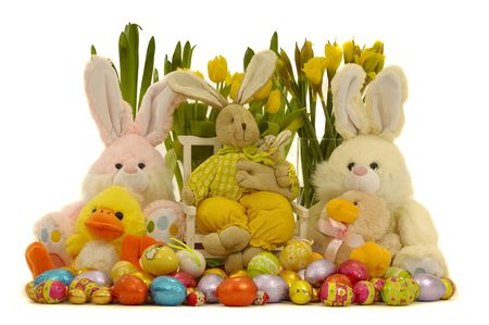 Easter decoration with eggs, bunnies, and flowers. photo