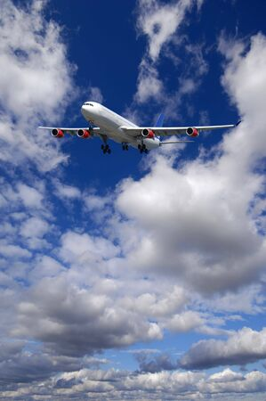 Air travel - Plane is flying in blue sky with clouds Stock Photo - 2707124
