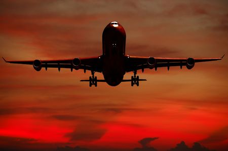 propulsion: Plane is flying while the sun is setting Stock Photo