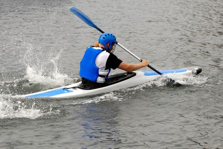 Man is racing in his kayak. photo