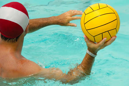 A man is playing water polo photo