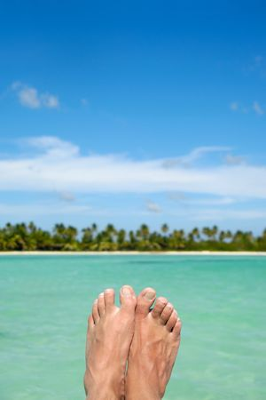 Feet abowe water, with an exotic beach with palms in the background. Taken at the Dominican Republic  photo