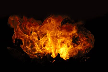 Fire isolated on a black background. photo
