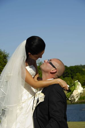 Bride and groom are about to kiss photo